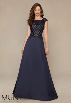 Size 12 Navy, MGNY by Mori Lee 71322 is a cap sleeve A-line Larissa Satin evening gown with Beaded Geometric Embroidery.