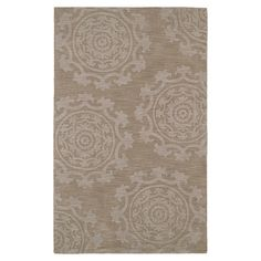 Anchor your living room seating group or define space in the den with this artfully handcrafted wool rug, showcasing a suzani medallion motif for eye-catchin...