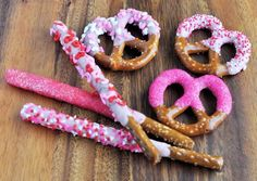 ~~***HAND DIPPED VALENTINE PRETZELS***~~     *Step 1*     Gather your favorite pretzel snacks. The large pretzel rods and twists work well for this sweet project but you can definitely dip the small sticks and twists too for a mini treat.     *Step 2*     Candy melts are a great product for a non-chocolate flavor and come ready in fun holiday colors like red, white and pink. When melted the candy, use a microwave-safe bowl and add 2 tablespoons of vegetable shortening to about a cup of candy…