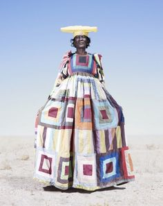 Great color~  Herero Tribe series by fine art photographer Jim Naughten shot in Namibia. Capturing dramatic portraits in the intensity of the Namibian landscape, the magnificent costume and characters of the tribe are all revealed in this amazing book called Conflict and Costume: The Herero Tribe of Namibia