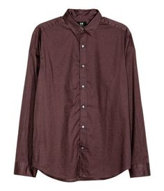 Dark plum. Long-sleeved shirt in soft, washed cotton fabric. Button-down collar with concealed buttons. Regular fit.
