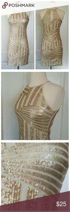 Sequin Hearts Champagne Gold Sequin Halter Dress Sequin Hearts champagne color dress, sequin pattern over mesh, lined, zipper and keyhole closure in back. Sequin Hearts Dresses