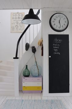 homes - norway house: white hallway with stairs with black shade and clock Guardian lifestyle Hallway Inspiration, Interior Inspiration, White Painted Floors, Norway House, White Hallway, White Stairs, Norwegian House, Estilo Interior, Chalkboard Decor