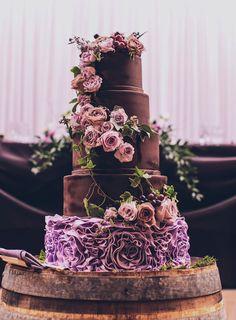 Purple ruffle chocolate wedding cake with pink roses
