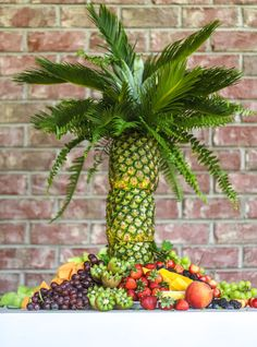 This is the cutest way to display fruit! A pineapple palm tree fruit tray will b… This is the cutest way to display fruit! A pineapple palm tree fruit tray will be the star of the show at your next summer BBQ or party! Palm Tree Fruit, Pineapple Palm Tree, Pineapple Fruit, Fruit Trees, Palm Trees, Pineapple Recipes, Fruit Salad Tree, Joe Wicks, Iftar
