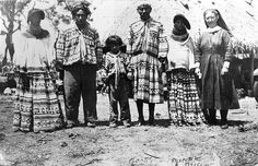 Deaconess Bedell posing with Miccosukee Indians at their camp by State Library and Archives of Florida, via Flickr