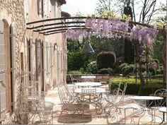 Terrace with wisteria covered pergola