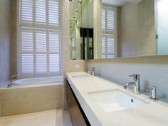 Popular Limestone tiles modern bathroom Modern bathroom with limestone tiles backsplash mirror and plantation shutters