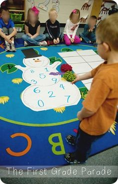 Cute! Kids throw a beanbag on the snowman then build the number it lands on in the ten frame. {First Grade Parade}