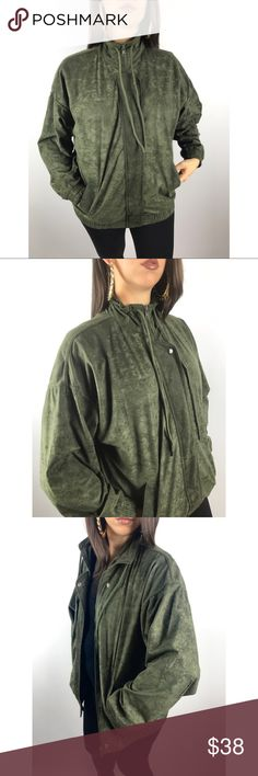 Vintage faux ultra suede green bomber by KAKTUS Vintage 1980s faux ultra suede bomber zip up by KAKTUS. Perfect vintage condition! Fully zips up to a mock neck with an additional flap that covers the zipper and snaps shut on top and the bottom. Elastic band around wrists of sleeves and waist. Lace around neck that can be tied. The fabric has a dope geometric triangular pattern throughout that was hard to capture in the photos. 100% polyester. Size Medium. Vintage Jackets & Coats Utility…