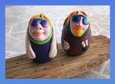 The Stoners on vacation.  Wood egg, covered with polymer clay, paper and paint