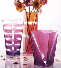 Painted Glass Vases. I am doing something similar in my bathroom. I bought clear tall square glasses from walmart, put pink christmas lights in the jar with clear or pearl colored marbles and stuck a few fake flowers in them. It's sooo pretty lit up! You can use any color lights and flowers to match your room!