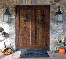 Rustic Double Doors with Arched Panels - The Santa Fe #rusticexteriordoors #wooddoorswithiron #exteriordoubleentrydoors