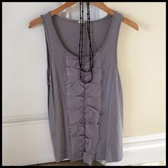 J.Crew Gray Ruffle Embellished Tank Top. Size M. Really cute detail down the front, great on its own or underneath a cardigan. Nice neutral color. Shown with black beaded necklace (sold separately in my closet...perfect bundle). Size M, great J.Crew classic style. Very well cared for, worn less than five times. Always washed in cold and hung to dry. J. Crew Tops Tank Tops