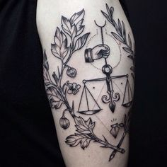 black justice tattoo