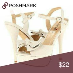 Luchiny Blond Heels Sexy And feminine peep toe design with bow accent. Fabric upper and adjustable buckle closure at ankle strap. Lightly padded footbed. Wrapped platform and stiletto heel. Heel high 5 inches platform height 1 1/2 in True color is Ivory white. Used once. Minor scuffs. Luchiny Shoes Heels