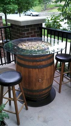 Wine Barrel Patio Table, love the scattered cork look too.