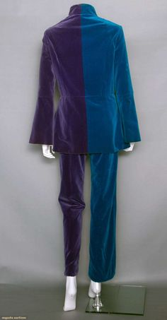 APPLE BOUTIQUE VELVET PANTSUIT, LONDON, 1968 (Rear View) ~ Designed by The Fool collective for The Beatles' short-lived Apple Boutique. Both pieces 2-tone purple & peacock blue velveteen, jacket w/ band collar, wavy F closure, bell sleeves, hip hugger tubular pants. Purchased Feb.1968 at the Apple Boutique.