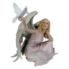Angel of Peace by Nemesis Now from Absolute Angels Lovely figurine of an Angel sitting cross legged Dressed in light pink she holds her right arm aloft