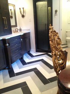 Gorgeous Chevron tile, gold antique chair, bathroom. Brandy Downing Design and tile from Tile Sensations