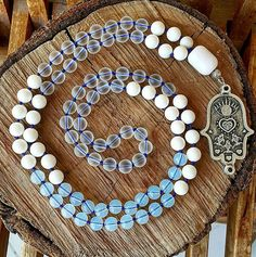 This mala necklace is made of 108 pieces; includes 3 different type of natural gemstones. 8 mm white jade 8 mm frosted transparent jade 8 mm moonstone ABOUT Jewelry Designer of Emotional Dreams offers an exciting collection, designed and handmade by designer herself. You will find a