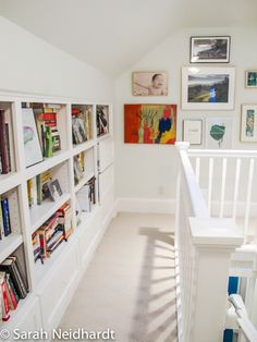 Bookshelves and artwork at upstairs landing