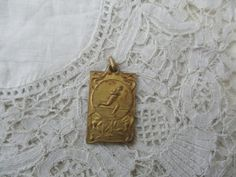 Antique running medal/pendant by Nkempantiques on Etsy