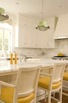 White kitchen cabinets never go out of style, but what happens when its too much white? Do you love white cabinets and want to experiment with color? Mixing upper and lower cabinet colors is a popular trend that has staying power. Tap to read our best design tips and white kitchen ideas to break up the white with a pop of color, a bold countertop, bright yellow bar stools, prints, gold or flashy kitchen cabinet hardware, and more. Hadley Court Interior Design Blog.