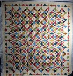 Storm at Sea by Jan Hutchison.  The quilting is beautiful.  One day, I'll be able to quilt something this complicated. For now I'll stick to my easy squares and diamonds!