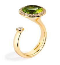 Satellite Peridot ring by Andrew Geoghegan. i'm not a fan of gold, but i love this design like crazy.
