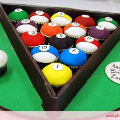 Completely edible billiards cupcake rack with pool cue, chalk and scorecard for a 50th birthday party. Cupcakes are mixture of chocolate with vanilla icing