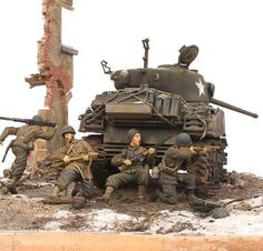 1/35 scale diorama 'Bulge 1944' by Patrick Dorn featuring the Sherman M4A3 (76)W, somewhere in a small Belgian village. U.S. Infantry is regaining territory which was lost some weeks ago during the German offensive in the Battle of the Bulge. #hobby #military #tank #scalemodel #history #ww2 #plasticmodel #scalemodels #scalemodelsworld #plastickit #hobbyboss #militarymodelling #tamiya #miniature #masterbox #diorama #miniart #dioramas #usarmy #sherman