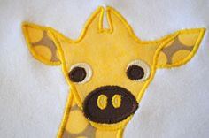 Tutorial on how to do appliques with a sewing machine and heat n bond. Good how to tips on here.