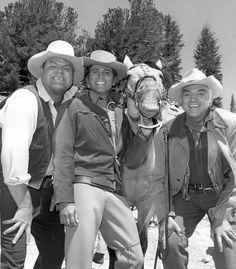 Bonanza cast from left to right: Dan Blocker, Michael Landon, Horse Guy and Lorne Greene.