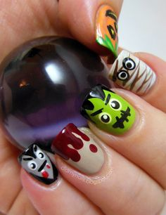 Cute Halloween nail art check out www.MyNailPolishObsession.com for more nail art ideas.