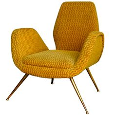 1950's Italian Chair with Splayed Brass Legs | From a unique collection of antique and modern lounge chairs at http://www.1stdibs.com/furniture/seating/lounge-chairs/