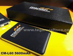 CM L-60, a powerbank 5600 mAh, comfort to hold with a texture that resembles leather. As shown beside a powerbank with two colors branding logo ordered by General Affair Bank Mandiri Region IX Kalimantan, Banjarmasin South Kalimantan, Indonesia