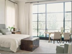 Soothing bedroom with lots of light and huge windows.