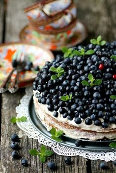 Bon Appétit <3 This doesn't have a recipe, but I love the simple way this cake is decorated. Fresh berries and mint and lightly frosted!