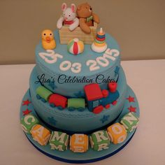 Two tier vanilla and chocolate christening cake filled with buttercream and fully decorated in fondant with fondant models and baby boys date of birth.