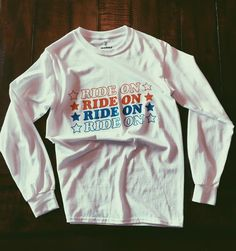 Ride On Long Sleeve Tee Available in White Sizes S, M, L 100% Preshrunk Cotton Printed in USA
