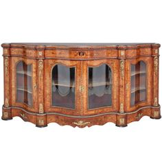 For Sale on - An imposing fabulous quality century walnut and floral marquetry credenza of serpentine form, the wonderfully shaped top having ormolu moulding, the