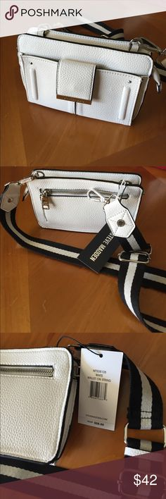 Steve Madden Clutch/Wallet on String/New This beautiful white SM clutch has a cool strap that is removable so you can convert it into a wallet, there are several compartments to stash cash and cards....the size is 5 x 8 inches Steve Madden Bags Clutches & Wristlets