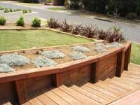 Australian United Timbers: Treated timber photo gallery such as retaining walls, landscaping decks and much more