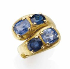 A SAPPHIRE AND GOLD 'MOI ET TOI' RING, BY SUZANNE BELPERRON