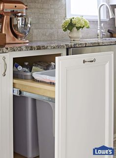 Put a pretty face on kitchen waste by hiding trash bins behind a cabinet pullout. Function meets style in this cabinetry disguise conveniently positioned by the sink in the kitchen cleanup zone. Kitchen Redo, New Kitchen, Kitchen Storage, Kitchen Remodel, Kitchen Design, Kitchen Cabinets, Kitchen Waste, Kitchen Ideas, Kitchen Cupboard