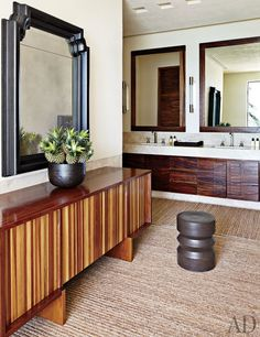 Cindy Crawford and Rande Gerber and Neighbor George Clooney's Side-By-Side Mexican Villas: Clooney's Master Bath - In the actor's master bath, Urban Archaeology sconces overlook the parota vanity, which has Waterworks sinks and fittin...