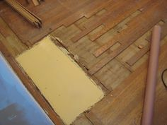 Durham's water putty is great for flooring repairs. Picture provided by http://www.picardyproject.com/2012/03/patching-our-hardwoods.html. Visit their website for detailed how-to instructions.