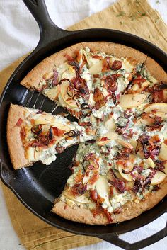 A pizza that's all dressed up and ready for fall. Caramelized Apple, Bacon + Blue Cheese Pan Pizza via Girl Versus Dough.