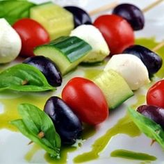 Mediterranean Appetizer Skewers with Basil Infused Olive Oil Drizzle. Healthy and vegetarian friendly
